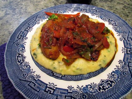 Sausage and peppers over herb polenta up close